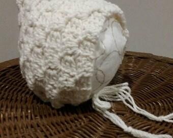 Newborn crocheted cream bonnet