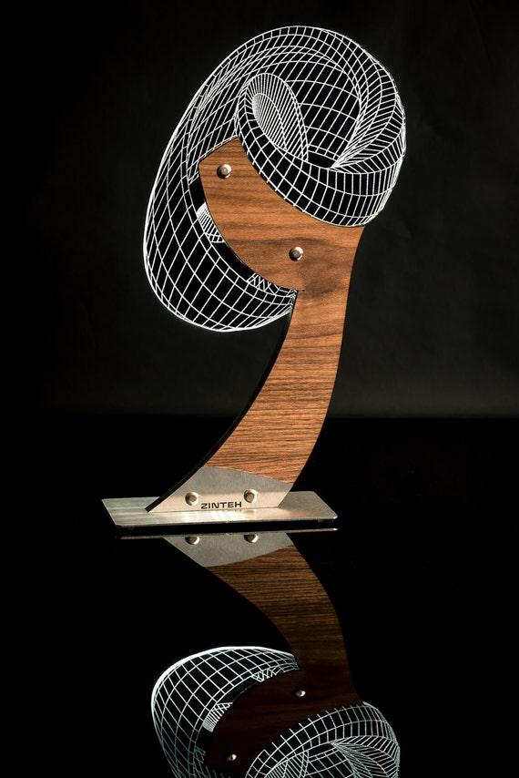 Umbra 3D Illusion table lamp designed by Zinteh.