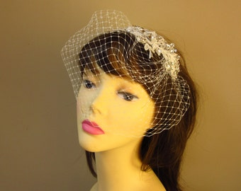Ivory bridal headpiece with beaded applique and net