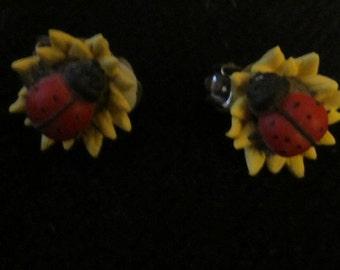 Ladybug on Sunflower clip earrings
