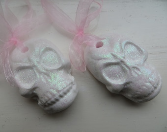 A pair of 'sugar Skulls'