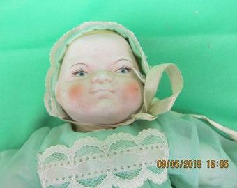 Vintage Porcelain Doll wearing Green Dress
