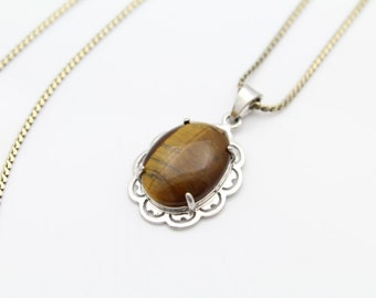 Vintage Sterling Silver and Oval Tigers Eye Cutout Pendant Necklace by RandG. [6554]