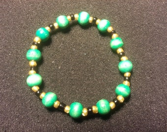 Green wood beads with gold & balck beads
