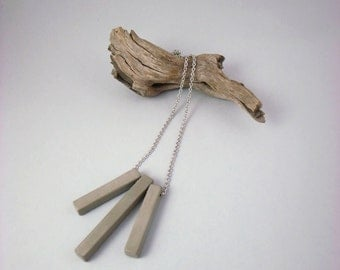 Concrete necklace. Hanging three pieces, hand-made cement.