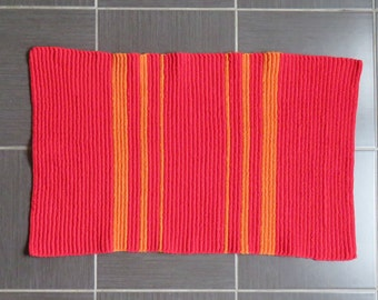 Hand made crochet striped orange and red bath mat/rug