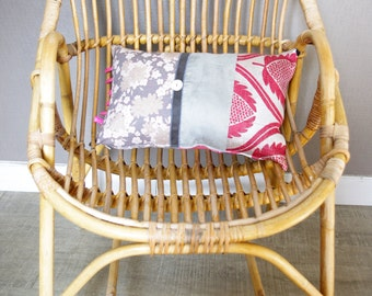 Grey and pink patchwork cushion