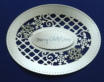 """Die Cut Shapes of Lattice Snowflake, Valley Snowflakes and """"Merry Christmas"""" Tag."""