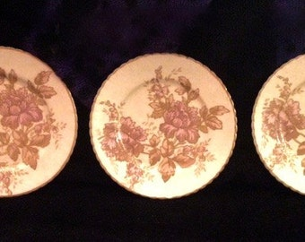 3 small plates/saucers with delicate gold and pink flowers
