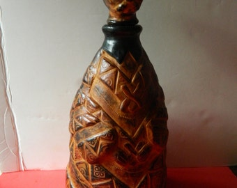 Hand tooled-leather-figural decanter=On SALE for-80 dollars