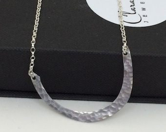 Contemporary hammered sterling silver pendant