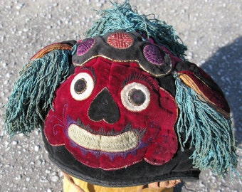 Vintage Chinese child's festival hat in the shape of a Foo Dog / Lion Dog guardian of temples