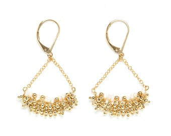 Golden earings fine gold / white and gold / gemstones: Freshwater Pearl / day of Mistral