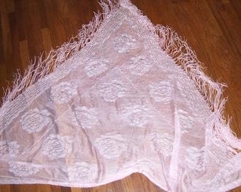 Vintage triangular shaped pink fringed shawl with rose pattern and loose string/fringe edging; rayon.