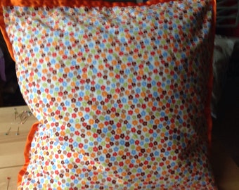 Orange ribbon cushion