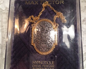 Max Factor Hypnotique Tapestry Creme Perfume Locket Necklace, As New In Original Box, Embossed Silver Front in Gold Beaded Frame.