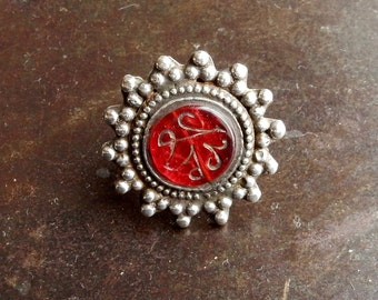 Silver ring with cabochon of red glass Hadj, Pakistan.