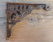 A lovely antique style cast iron wall light hanging bracket hook bracket