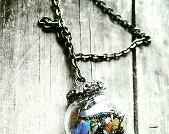 The Butterfly Kiss , Crystal Ball Amulet