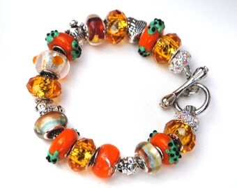 european charm bracelet turtle charm beads orange and amber tones bar clasp charm bracelet tibetan silver