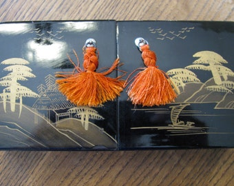 Black Lacquer Chinese two door jewelry box with orange tassels
