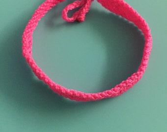 Neon pink friendship bracelet