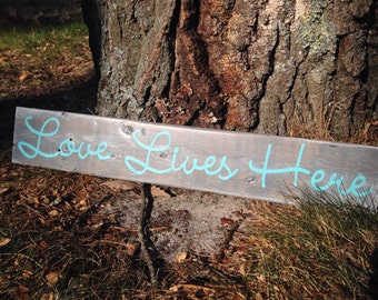 Love Lives Here Rustic Wood Sign - Gray Stain & Teal Text