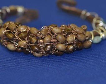 Copper cuff with sterling silver, and wooden beads