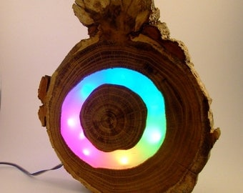rainbow lamp, colour light, color changing lamp, in red, green, blue, yellow, violet, purple. Made from wood, led and resin.