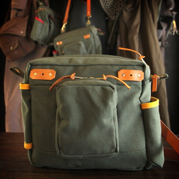 Waxed canvas and leather fly fishing bag with creel style for Fly fishing bag