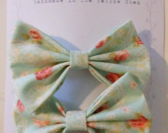 Set of 2 Fabric Bow Hair Clips, Blue with Roses