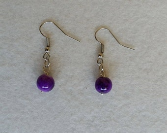 Sterling silver earrings with purple glass drawbench beads