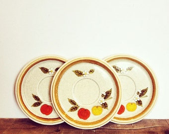 Set of three matching 1970's Mikasa saucers - 'Temptation' pattern, with very retro apple design. Gorgeous speckled stoneware.