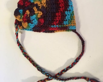 Crocheted baby hat with flower and ties Size 3-6 months