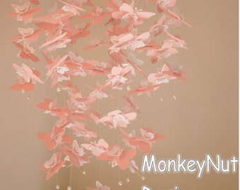 Pink butterfly mobile. Butterfly Crib Mobile: Butterfly Mobile. Pink. White. Butterfly. Photo prop. Baby shower. Baby nursery. Decor.