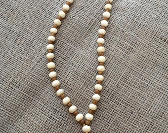 Ivory and wood beaded pink tassel necklace