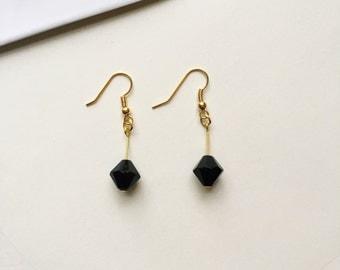 Black faceted diamond shaped bead dangle drop earrings