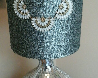 Teal sequin fabric covered drum lamp shade with jewel accent