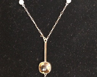 Gold gemstone and pearl necklace