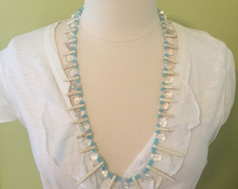 "Long crystal, blue faceted bead and howlite spike bead necklace, 30""L."