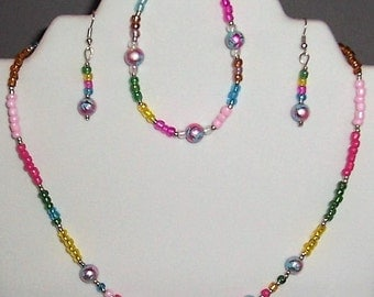Multi colored, aqua, blues, pinks, yellows, Necklace, Bracelet and Earrings. Very Versital, Free Shipping