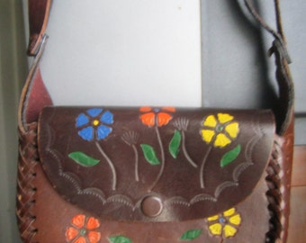Hand crafted leather purse, engraved with flowers