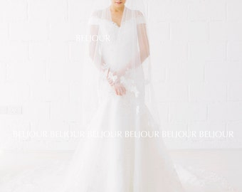 Swarovski crystal and pearl beaded bodice, delicate illusion cap sleeves, hand sewn guipure lace on tulle