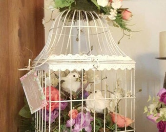 White large bird cage floral design