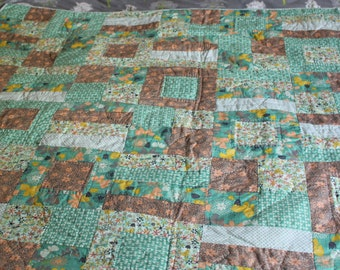 Handmade lap quilt or tablecloth. 100% cotton quilt top with calico back. Machine pieced and hand quilted.
