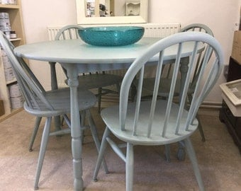 Dining table and four Ercol chairs