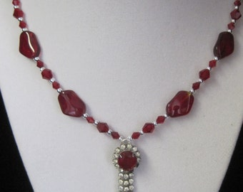 20 inch Beautiful Red with Crystals and Glass  beads. The Drop is a Red stone with Rhinestones and Red tips.