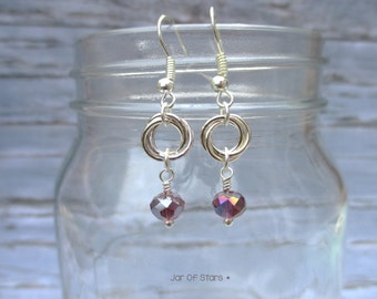 Flower knot earrings, with silver-plated chain maille flower knots and pale purple crystal beads.