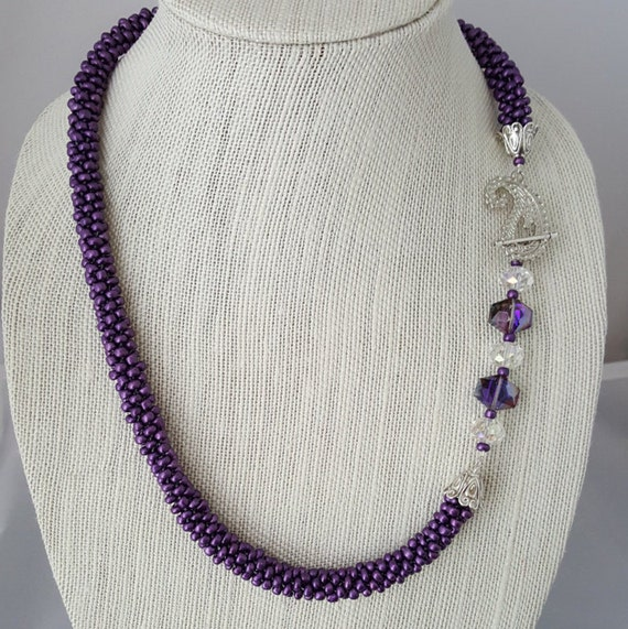 Purple beaded kumihimo woven necklace with fancy clasp
