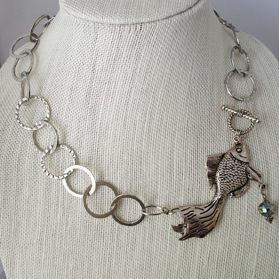 Silver chain necklace with fish pendant